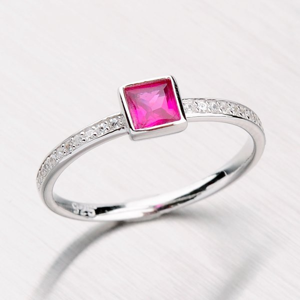 Stříbrný prsten se syntetickým rubínem a zirkony RXC15140057RUB