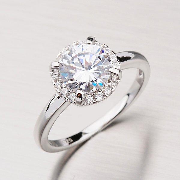 Stříbrný prsten se zirkony RXX07170510